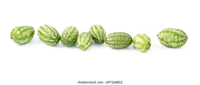 Row of eight cucamelons, Mexican sour gherkin, pepquino, or mouse melon, isolated on a white background