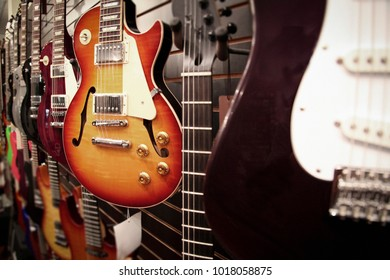Row of Electric Guitars for sale in a shop