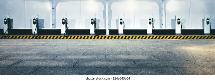 A Row of Electric Vehicle Charging Piles at Station