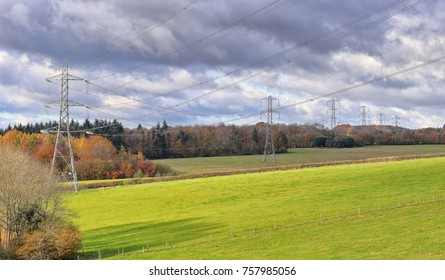 Row of Electricity Pylons in the Chiltern Hills in rural England