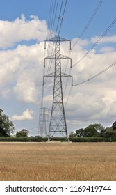 Row of Electricity Pylons in an English Rural Landscape in the Chilterns