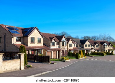 Row of elegant detached houses, english street view