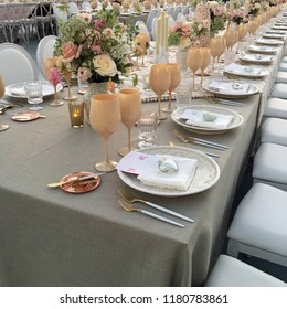 Row of elegant table setting up for event