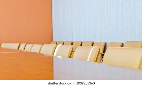 Row of empty chairs in the conference room