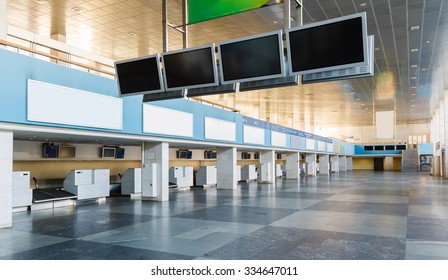row empty check-in desks in abandoned airport
