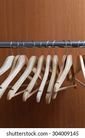 Row of Empty Hangers on Clothes Rack