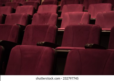 Row of empty red seats for cinema, theater, conference or concert