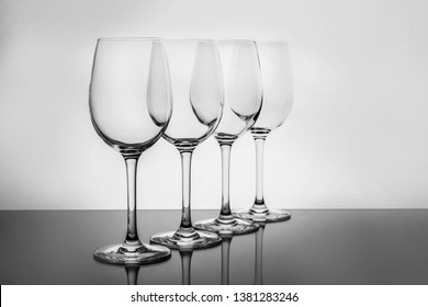 Row of empty wine glasses on white background