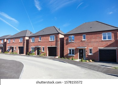 Row of english detached houses with garage