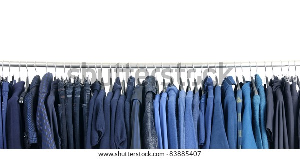 Row of fashion clothes on hangers