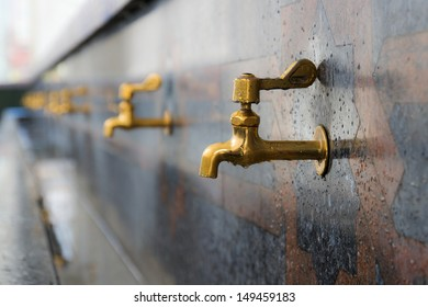 A row of faucets for ablution in Sultan Omar Ali Saifuddien Mosque, Bandar Seri Begawan, Brunei