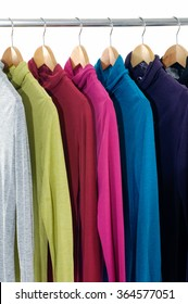 Row of female clothing hanging on hangers