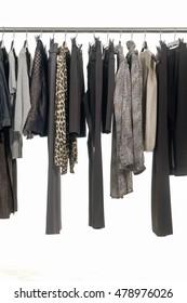 Row of female clothing hanging on hangers-white background