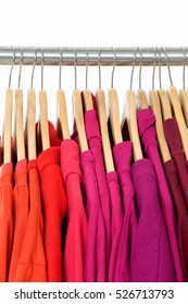 Row of female colorful clothes on Hangers
