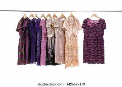 Row of female colorful clothing , floral pattern sundress on display