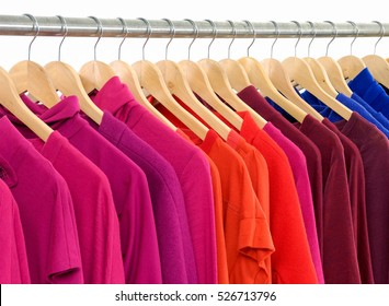 Row of female colorful shirt clothes on Hangers