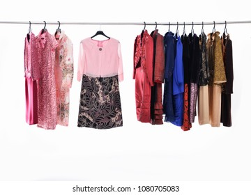row of female floral,colorful sundress, on hanger isolated-white background