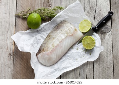 Row fish fillet, codfish on greaseproof paper