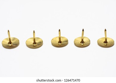 A row of five drawing pins