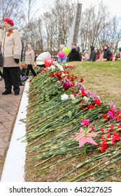 A row of flowers on a mass grave. Kirishi, Russia - 9 May, 2017. Laying wreaths and flowers in memory of the fallen at the Eternal Flame.