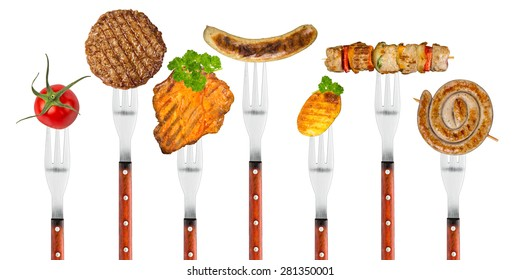 row of forks with grilled food