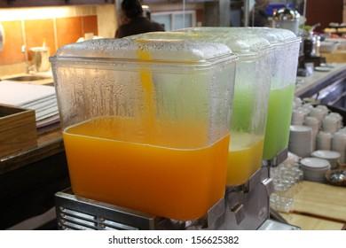 Row of fresh juice at buffet hotel restaurant.