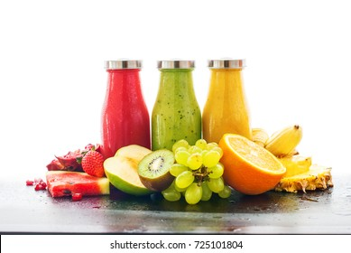 Row Fresh Juices Smoothie Three Bottles Red Green Orange Fruits Vitamins Healthy Concept isolated on white