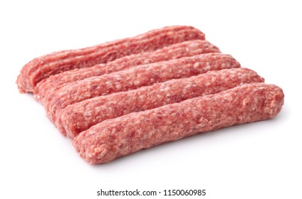 Row of fresh raw beef kebabs isolated on white