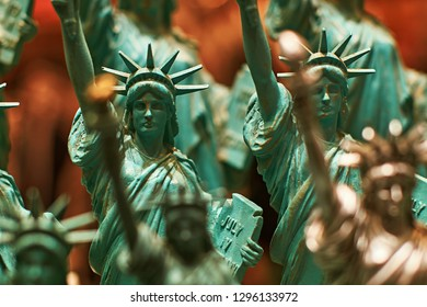 Row with generic Statue of Liberty statues sold as souvenirs in a New York shop - selective focus.