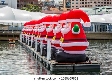 Row of gigantic inflatable Father Chritsmas's floating in Darling Harbour, Sydney, NSW, Australi taken on 7 December 2014