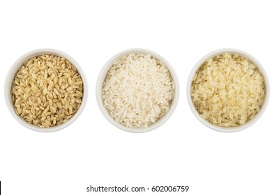 Row glass bowls with parboiled, polished, brown rices isolated on white background. Top view