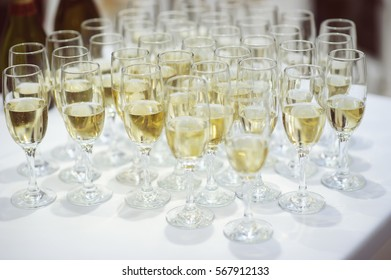 row of glasses filled with champagne