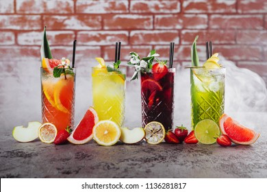Row of glasses with fruit mojito coctails in smoke