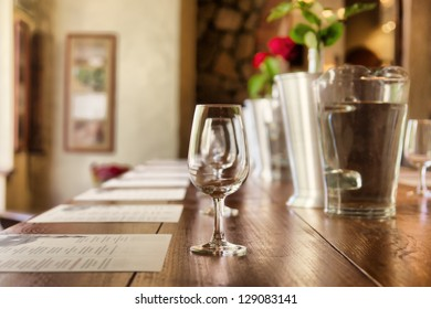 Row of glasses in a restaurant. Shot in South Africa.