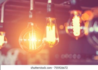 Row of glowing electric light bulbs