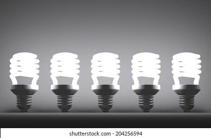 Row of glowing fluorescent light bulbs on gray textured background