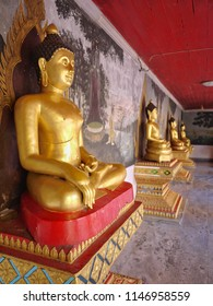 Row of golden Bhudda statue in Doi Suthep Temple, Chiang Mai, Thailand