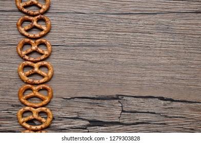 A row of golden brown pretzels