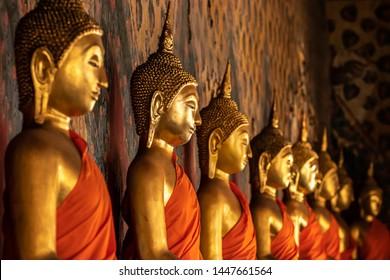 Row of Golden Buddha statue in Thailand, Beautiful golden Buddha statues.