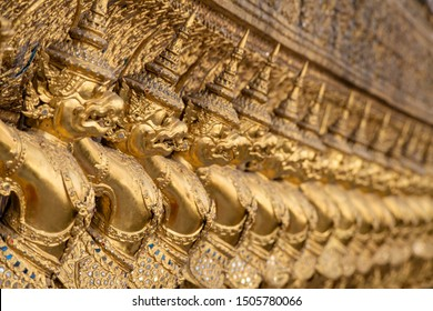Row of golden Kinnari statues in The Temple of the Emerald Buddha