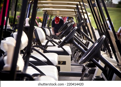 Row of golf carts in the morning