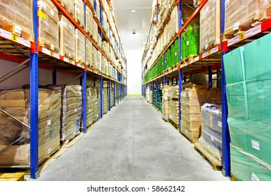 Row with goods in big industrial warehouse