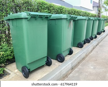 row of green plastic bin