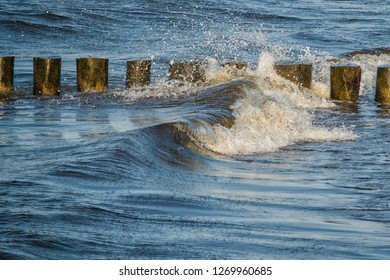 a row of groynes in the surge of waves of the baltic sea, Germany, Europe