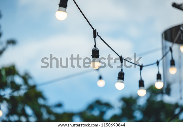 Row Hanging Summer Terrace Lights During Stock Photo Edit Now 1150690844