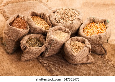 Row healthy grain food (corn, sesame, flax, buckwheat, wheat, pumpkin seed) in jute sack.