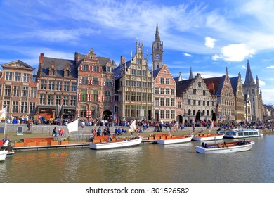 Row of historic buildings along the tourist boats floating on the river, Ghent, Belgium