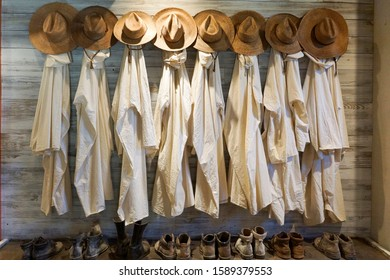 Row of historical robes, hats and shoes of Trappist monks in Conyers, Georgia, USA