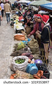 Row of Hmong women  stands selling local products at Sapa market  in Vietnam.Life in Sapa.Photo taken at Sapa,Vietnam.Date : October 15,2017.