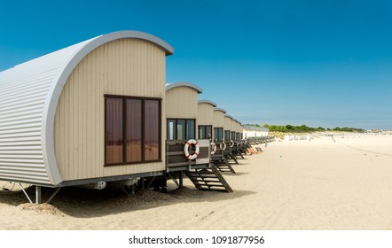 Row of Holiday houses on the beach of Zeeland in the Netherlands
